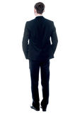 Back view of a young businessman standing Stock Photo