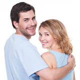 Back view of young couple in embrace. Back view of young couple in embrace standing on white background Stock Photography
