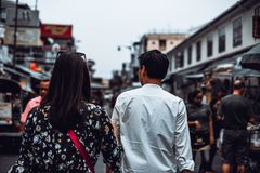 Back view of young couple enjoy walking at Khaosan Road, Bangkok. Back view of young couple enjoy walking at Khaosan Road, Bangkok Stock Images