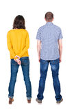 Back view of young couple  hug and look into the distance. Stock Image
