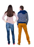 Back view of young couple  hug and look into the distance. Royalty Free Stock Photo