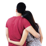 Back view of young couple. Look into the distance.  Isolated on white background Stock Image
