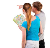 Back view journey of the young couple looking at the map. Stock Photo