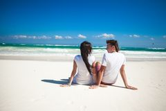Back view of young couple in love sitting at Royalty Free Stock Image