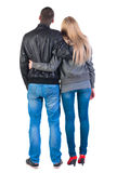 Back view of young couple (man and woman) hug and look into the Royalty Free Stock Image