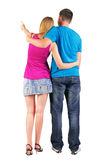 Back view of young couple pointing Stock Images