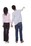 Back view of young couple pointing royalty free stock photography