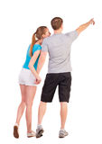 Back view of young couple pointing at wall Royalty Free Stock Image