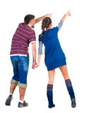 Back view of young couple pointing at white wall Royalty Free Stock Image