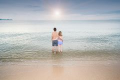 Back view Young Couple romantic travel honeymoon on Beach. In summer holidays Royalty Free Stock Photo
