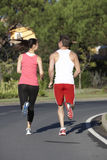 Back View Of Young Couple Running On Road Royalty Free Stock Photo