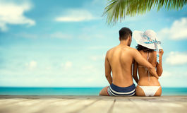 Back view of young couple on sea cost Royalty Free Stock Images