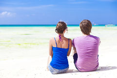 Back view of young couple sitting and having fun Royalty Free Stock Images