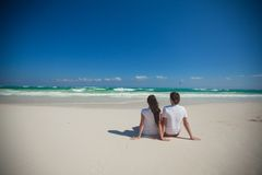 Back view of young couple sitting at tropical Royalty Free Stock Image