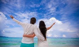 Back view of young couple spread their arms Stock Photo