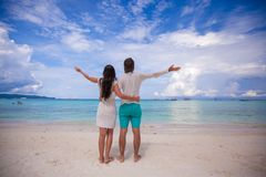 Back view of young couple spread their arms Royalty Free Stock Images