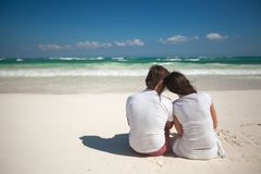 Back view of young couple at tropical white beach Royalty Free Stock Photos