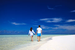 Back view of young couple on white beach. Vacation concept Royalty Free Stock Image