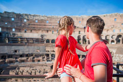 Back view of young dad and little girl in Coliseum, Rome, Italy. Family portrait at famous places in Europe Stock Photography