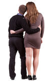 Back view of young embracing couple Royalty Free Stock Photography