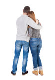 Back view of young embracing couple (man and woman) hug and look Royalty Free Stock Photography