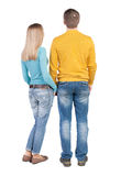 Back view of young embracing couple (man and woman) Royalty Free Stock Images