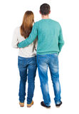Back view of young embracing couple Stock Images