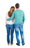 Back view of young embracing couple Royalty Free Stock Photos