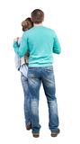Back view of young embracing couple (man and woman) Royalty Free Stock Image