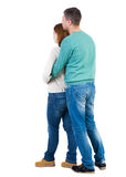Back view of young embracing couple Stock Image