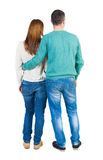 Back view of young embracing couple Stock Photo