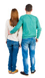 Back view of young embracing couple Stock Photos