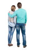 Back view of young embracing couple (man and woman) who hugs and looks Royalty Free Stock Photo