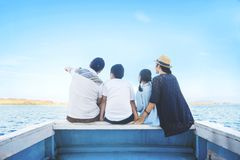 Young family enjoying a blue sea Stock Image