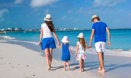 Back view of young family with two kids on Royalty Free Stock Images