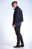 Back view of a young fashion man in leather jacket Stock Images