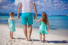 Back view of young father and his two little kids Royalty Free Stock Image