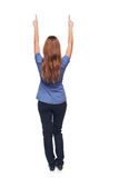 Back view of young female standing in full length Stock Photo