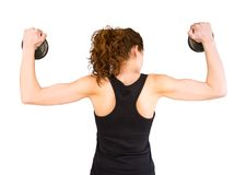 Back view of young girl lifting dumbbell discs Stock Photos