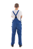 Back view of young handsome man in blue workwear isolated on whi Stock Images
