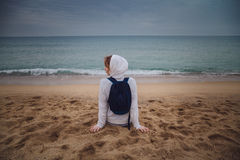 Back view of young lonely woman relaxing on beach in Barcelona,. Spain. Vacation background Royalty Free Stock Photography