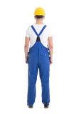 Back view of young man in blue builder uniform isolated on white Royalty Free Stock Images