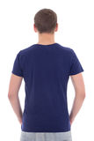 Back view of young man in blue t-shirt isolated on white. Background Stock Photo