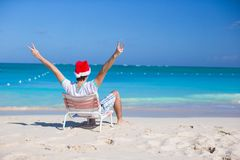 Back view of young man in Christmas hat at beach Royalty Free Stock Photos