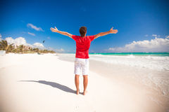 Back view of Young man enjoying the holiday on Stock Images