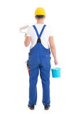 Back view of young man painter in blue coveralls isolated on whi Stock Image