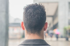 Back view of a young man posing in the city streets Royalty Free Stock Photography