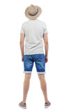 Back view of young man in shorts and hat. Stock Photography