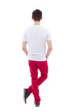 Back view of young man standing isolated on white Stock Image