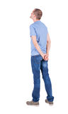 Back view of young man in t-shirt and jeans Royalty Free Stock Photo